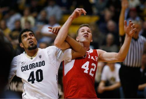 Colorado forward Josh Scott, left, locks arms with Utah forward Jakob Poeltl as they jostle for position for a rebound in the second half of an NCAA college basketball game Saturday, Feb. 7, 2015., in Boulder, Colo. Utah won 79-51. (AP Photo/David Zalubowski)