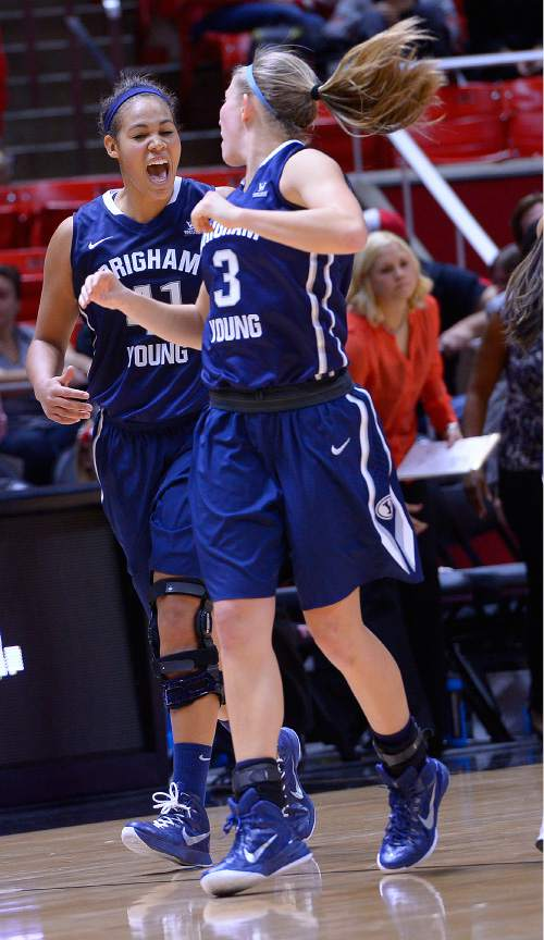 Leah Hogsten  |  The Salt Lake Tribune Brigham Young Cougars forward Morgan Bailey (41) and Brigham Young Cougars guard Ashley Garfield (3) celebrate the win. The University of Utah lost to  Brigham Young University 60-56, Saturday, December 13, 2014 at the Jon M. Huntsman Center.