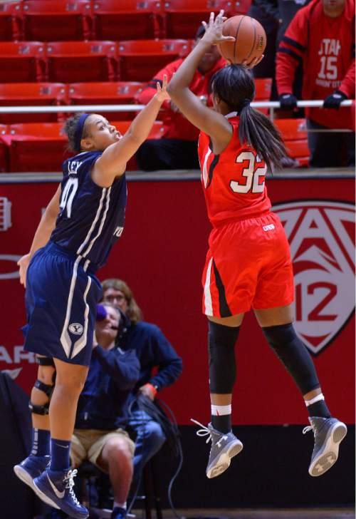 Leah Hogsten  |  The Salt Lake Tribune Brigham Young Cougars forward Morgan Bailey (41) tries to block Utah Utes forward Tanaeya Boclair (32). The University of Utah lost to  Brigham Young University 60-56, Saturday, December 13, 2014 at the Jon M. Huntsman Center.
