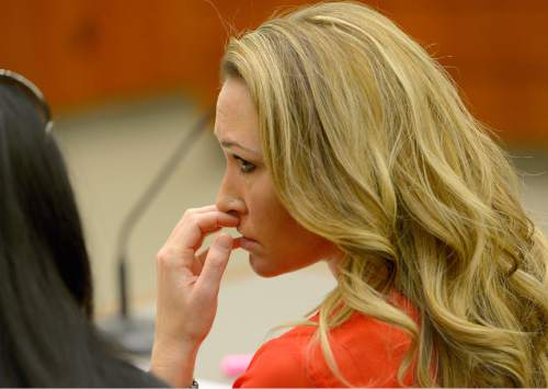 Leah Hogsten     Tribune file photo Brianne Altice listens in January to the testimony of a teenager who gave details about his sexual relationship when he was 17-years old with Altice, his former Davis High School teacher during a preliminary hearing in 2nd District Court. The boy's family has filed suit against Davis County School District seeking damages for abuse by Altice.