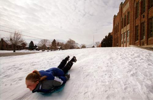 A sledder slides past the old Bingham High in Copperton in January of 2001. The school was torn down in 2002. Tribune file photo by Danny La.