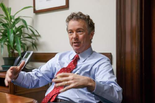 In this photo taken Feb. 10, 2015, Sen. Rand Paul, R-Ky. speaks in his office on Capitol Hill in Washington.  Paul said he is likely to announce whether he'll run for president in 2016 sometime in March or April from his home state of Kentucky. The Kentucky Republican told reporters after a Friday speech in Louisville that he was getting closer to making a decision, but all signs point to Paul launching a campaign. Next month, he will ask the state Republican Party to create a presidential caucus in 2016. That way, Paul could run for president and re-election to his Senate seat simultaneously without appearing on the primary ballot for two offices. That's banned by Kentucky law.  (AP Photo/J. Scott Applewhite)