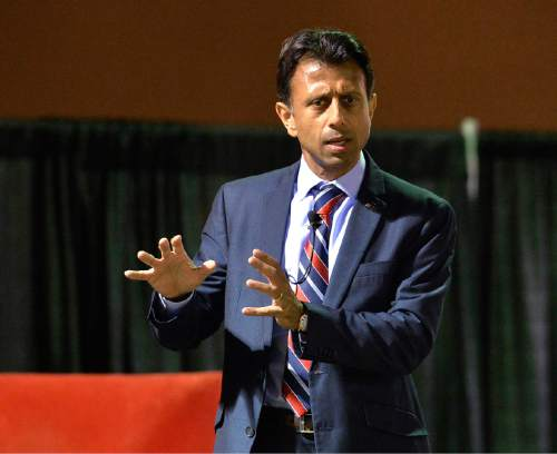 FILE - In this Oct. 29, 2014 file photo, Louisiana Gov. Bobby Jindal speaks in Louisville, Ky. Jeb Bush and Mitt Romney are getting most of the attention in the early days of the Republican race for president. But as they court the party's elite donors, some potential 2016 candidates who are to the right are just as eagerly chasing early support among evangelicals and social conservatives. (AP Photo/Timothy D. Easley, File)