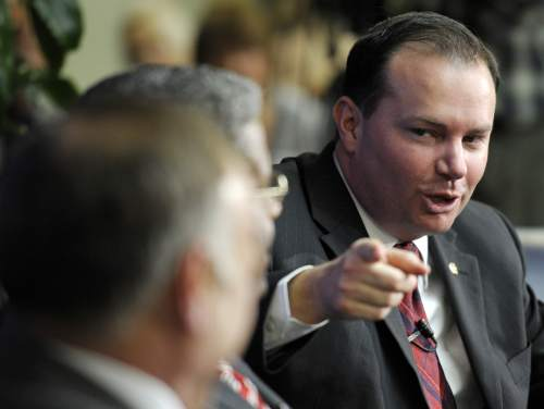 Sen. Mike Lee, R-Utah, speaks during a Tea Party town hall meeting at the National Press Club in Washington, Tuesday, Feb. 8, 2011. (AP Photo/Cliff Owen)