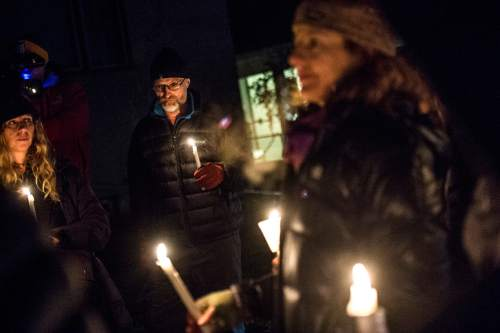 Chris Detrick  |  The Salt Lake Tribune Friends, family and community members participate in a candlelight vigil for James Barker near 2nd Avenue and I Street Thursday January 15, 2015.  Barker was shot and killed by a Salt Lake City police officer last week.