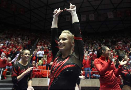 Kim Raff  |  The Salt Lake Tribune Utah gymnast Georgia Dabritz celebrates with her teammates after  receiving a 10.00 for her routine on the uneven bars a during a meet against Florida at the Huntsman Center in Salt Lake City on March 16, 2013.