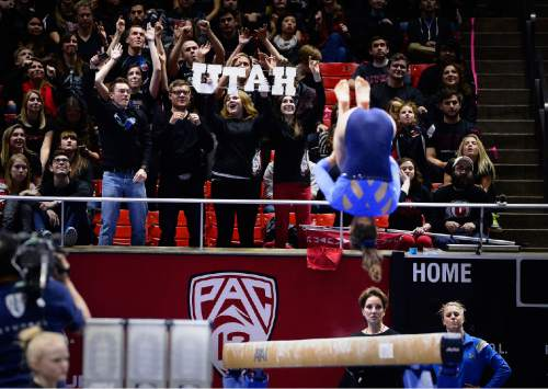 Scott Sommerdorf   |  The Salt Lake Tribune Utah fans cheer during the practice period as UCLA warms up on the beam. Utah Gymnastics defeated UCLA 196.725 - 194.725 in the Huntsman Center, Friday, January 23, 2015.