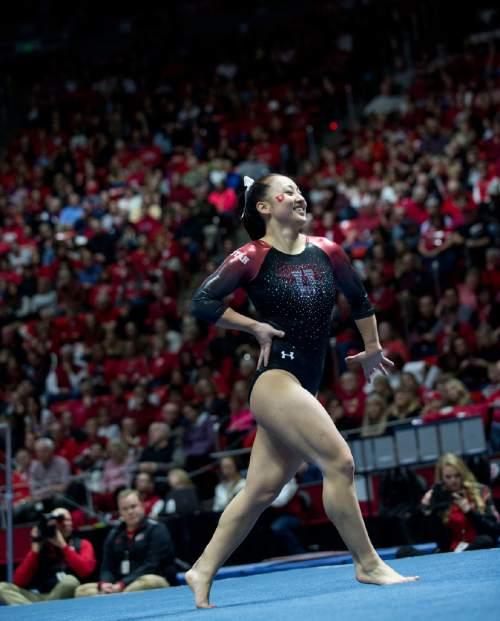 Lennie Mahler  |  The Salt Lake Tribune Corrie Lothrop scores a 9.800 on her floor routine during a super meet at the Huntsman Center on Friday, Jan. 16, 2015.