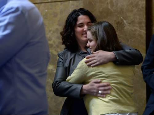 Scott Sommerdorf   |  The Salt Lake Tribune Emily Campbell hugs her daughter Maddy after Maddy spoke at a press conference about Senator Mark Madsen's bill SB259 - Medical Cannabis Amendments - passed out of committee, Thursday, February 26, 2015. Campbell has daughters who have found that their symptoms have lessened the negative affects of chemotherapy. Thursday, February 26, 2015.