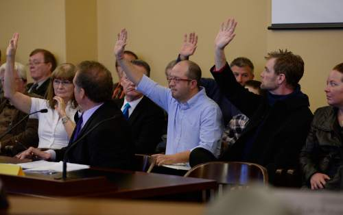 Scott Sommerdorf   |  The Salt Lake Tribune Many members of the public, including Aaron Campbell, center, raised their hands as the committee chair asked how many in attendance wanted to comment on Senator Madsen's bill, SB259 - Medical Cannabis Amendments, Thursday, February 26, 2015. Campbell has daughters who have found that their symptoms have lessened the negative affects of chemotherapy.