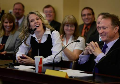 "Scott Sommerdorf   |  The Salt Lake Tribune Tenille Farr laughs along with Sen. Mark Madsen, R-Saratoga Springs, after she mistakenly referred to him as ""Governor Madsen"" as she gave her presentation in favor of his bill, SB259 Medical Cannabis Amendments - in committee, Thursday, February 26, 2015."