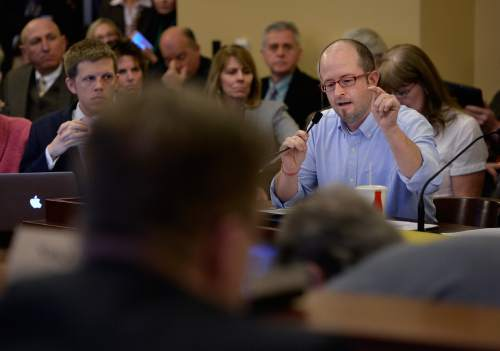 Scott Sommerdorf   |  The Salt Lake Tribune Aaron Campbell speaks during the committee meeting considering Senator Mark Madsen's bill, SB259 - Medical Cannabis Amendments - passed out of committee, Thursday, February 26, 2015. Campbell has daughters who have found that their symptoms have lessened the negative affects of chemotherapy.
