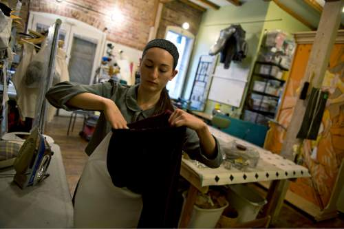 Lennie Mahler  |  The Salt Lake Tribune  Bailey Francom works on a costume in the backshop of McGrew Studios costume store on Pierpont Avenue, Friday, Feb. 27, 2015. The Eccles Browning Warehouse, a long-time home to small artisan businesses, was sold in January to an out-of-state residential developer. McGrew Studios is one of many tenants likely to be displaced by the change in ownership.