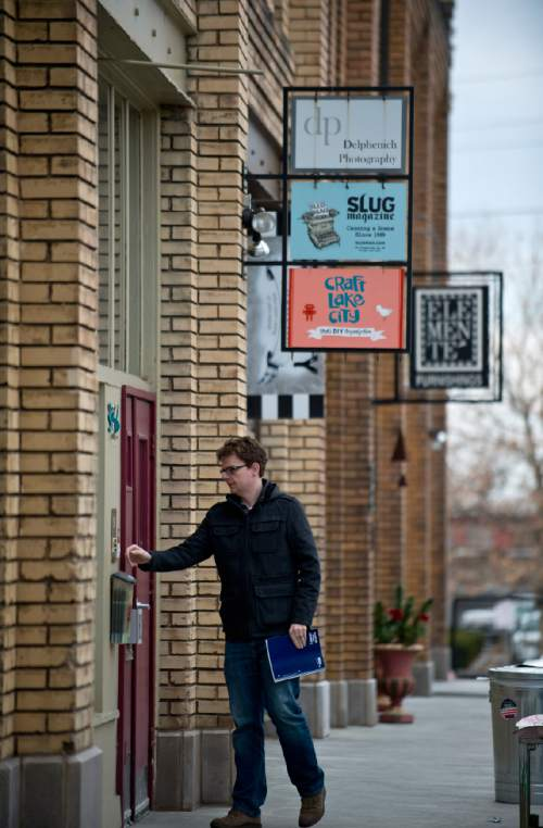 Lennie Mahler  |  The Salt Lake Tribune  A man rings the door to the SLUG Magazine space on Pierpont Avenue between 300 and 400 West in Salt Lake City, Friday, Feb. 27, 2015. The Eccles Browning Warehouse, a long-time home to small artisan businesses, was sold in January to an out-of-state residential developer.