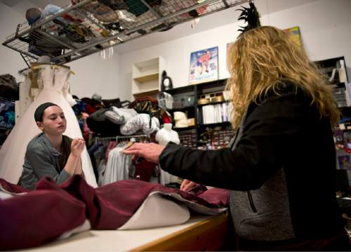 Lennie Mahler  |  The Salt Lake Tribune  Bailey Francom, left, and Jen McGrew, owner/proprietor of McGrew Studios, work on a costume in the backshop of McGrew's store on Pierpont Avenue, Friday, Feb. 27, 2015. The Eccles Browning Warehouse, a long-time home to small artisan businesses, was sold in January to an out-of-state residential developer. McGrew is one of many tenants likely to be displaced by the change in ownership.
