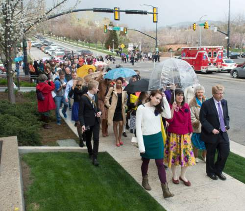 Steve Griffin  |  The Salt Lake Tribune Members and supporters of the Ordain Women, led by Hannah Wheelwright and Kate Kelly, center, walk to the Tabernacle on Temple Square to seek standby tickets to the all-male general priesthood meeting in Salt Lake City in April, 2014.