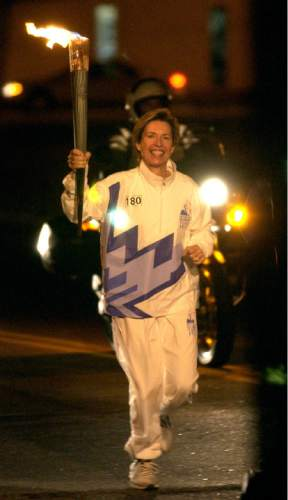 Steve Griffin  |  The Salt Lake Tribune  Former Salt Lake City Mayor Deedee Corradini carries the Olympic Torch through the streets of Greenville, South Carolina, on Dec. 4, 2001.