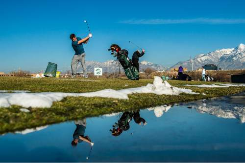 Chris Detrick  |  The Salt Lake Tribune In mid-fifty degree weather, Utah Valley University senior golfer Michael Dart hits golf balls on the driving range at Mulligans Golf And Games Wednesday January 7, 2015.