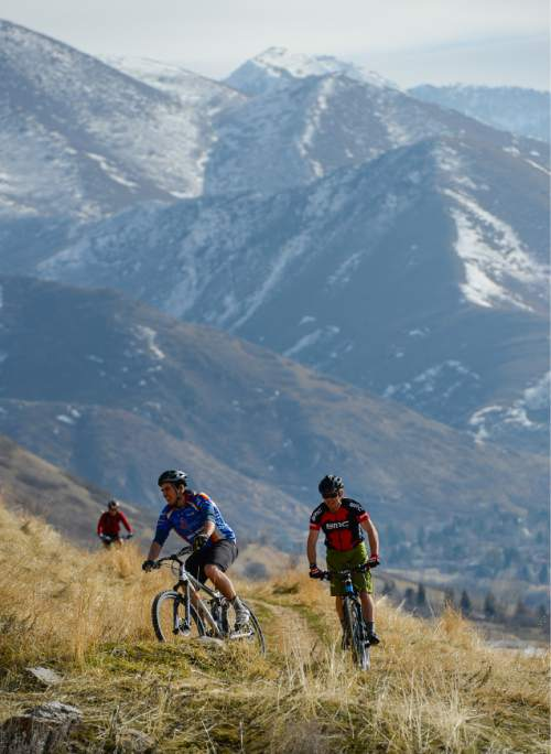 Francisco Kjolseth  |  The Salt Lake Tribune  Unseasonably warm weather draws people outdoors along the dry shoreline trail as bikers, runners, walkers and their dogs enjoy temperatures in the high 50's on Sunday, Feb. 1, 2015.