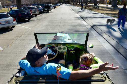 "Scott Sommerdorf   |  The Salt Lake Tribune Jim Johnson and his daughter Autumn Sky ""Bogi"" Johnson decided to take a drive through Liberty Park in his rebuilt 1929 Ford Roadster because of the nice weather, Sunday, February 8, 2015."