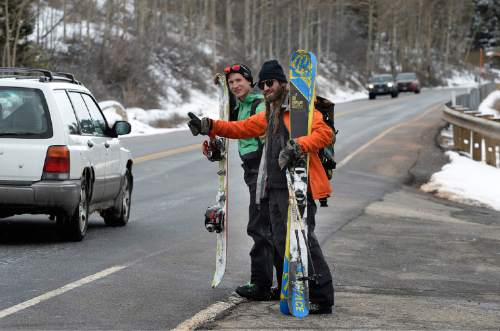 Scott Sommerdorf   |  The Salt Lake Tribune Friends Sean Brass and Shane Metos were looking for a ride to Brighton as they left the Silver Fork area of Little Cottonwood Canyon to ski/snowboard in the new snow, Sunday, March 1, 2015.