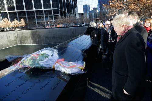 AP file photo   Boris Johnson, the mayor of London , lays a bouquet of flowers on the south pool during a tour of the National September 11 Memorial, Friday, Feb. 13, 2015, in New York. (AP Photo/Mary Altaffer)