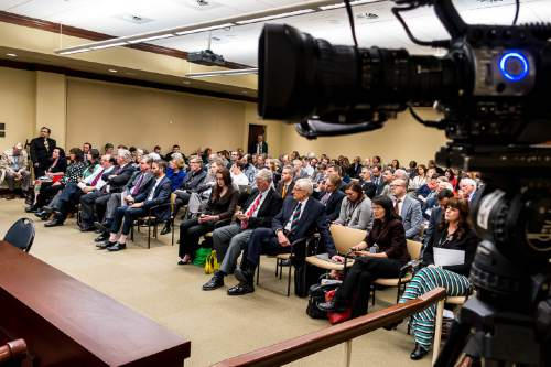 Trent Nelson  |  The Salt Lake Tribune A full room listens as Sen. Brian Shiozawa, R-Cottonwood Heights, speaks on his bill, SB164, which later failed to pass during a meeting of the House Business and Labor Committee at the State Capitol Building in Salt Lake City, Wednesday March 4, 2015. SB164 would have enacted Healthy Utah, the Governor's plan for expanding Medicaid to cover those in the so-called coverage gap and even more low-income Utahns.