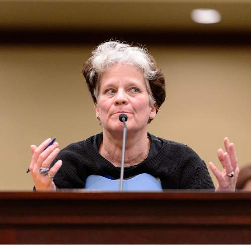 "Trent Nelson  |  The Salt Lake Tribune Diane Anderson, a citizen in the coverage gap, speaks about a bill, SB164, which later failed to pass during a meeting of the House Business and Labor Committee at the State Capitol Building in Salt Lake City, Wednesday March 4, 2015. Anderson, speaking of people without health insurance, said, ""All we can do is go in a corner and die."" SB164 would have enacted Healthy Utah, the Governor's plan for expanding Medicaid to cover those in the so-called coverage gap and even more low-income Utahns."