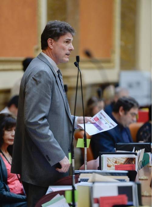 Francisco Kjolseth     The Salt Lake Tribune  Representative James Dunnigan, R-Taylorsville, brings to the House Floor HB446, the Utah Cares bill on Friday, March 6, 2015.