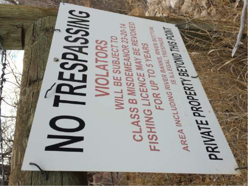 """Courtesy     Utah Stream Access Coalition  A signed posted on the upper Weber River warns anglers they could be cited for trespassing and lose fishing privileges if they fish on private property. The sign has been modified to remove the words """"or floating"""" from the list of prohibited activities.  Two lawsuits brought by stream access advocates are attacking a controversial Utah law that greatly limit public access to rivers that flow through private property. Floating such waters, including the Weber, remains legal as long as the boater does not stop or touch the stream bed."""