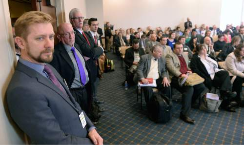 Al Hartmann  |  The Salt Lake Tribune  LGBT advocate Troy Williams, left, stands at the side of a full committe room to hear the Antidiscrimination and Religious Freedom, SB296 sponsored by Sen. Stephen Urquhart, R, Saint George, and Sen. Stuart Adams, R-Layton, as it gets its first hearing Thursday March 5 in the Senate Business and Labor Committee.