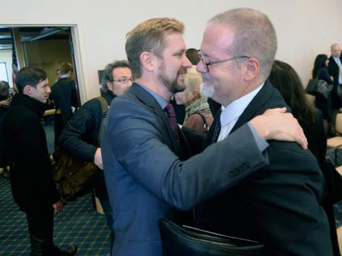 Al Hartmann  |  The Salt Lake Tribune  LGBT advocate Troy Williams, left, gives a hug and thanks to Sen. Stephen Urquhart after the Antidiscrimination and Religious Freedom, bill SB296 sponsored by Urquhart and Sen. Stuart Adams  passed through the Senate Business and Labor Committee Thursday March 5.