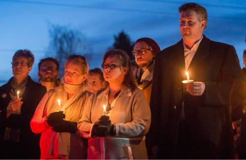 Rick Egan  |  The Salt Lake Tribune  Supporters of John Dehlin hold a candlelight vigil at the North Logan LDS Stake Center as they wait for the decision from Dehlin's disciplinary council in North Logan, Sunday, February 8, 2015