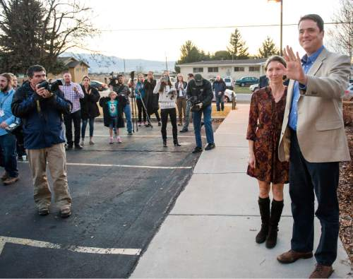 Rick Egan  |  The Salt Lake Tribune  John Dehlin and his wife greet a crowd of more than 200 people as they arrive at the North Logan LDS Stake Center for the disciplinary council in North Logan, Sunday, February 8, 2015