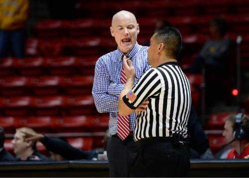 Scott Sommerdorf      The Salt Lake Tribune Utah head coach Anthony Levrets has a discussion with a referee during a second half time out. Arizona State beat Utah 58-48, Sunday, February 1, 2015.