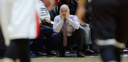 Steve Griffin  |  The Salt Lake Tribune  University of Utah women's basketball head coach Anthony Levrets holds his head in is hands in disbelief after a call went against the Utes during the Utah versus Idaho State women's basketball game at the Huntsman Center on the University of Utah campus in Salt Lake City, Wednesday, December 10, 2014.
