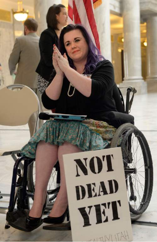 Al Hartmann  |  The Salt Lake Tribune  Stacy Stanford, a Westminster College student, gets set to speak at the Capitol Rotunda on Thursday, March 5, 2015. She and hundreds of citizens and advocates of the governor's plan to expand Medicaid, Healthy Utah, rallied.  She uses a wheelchair after an auto accident resulted in a neurolgical disorder. She is uninsured.