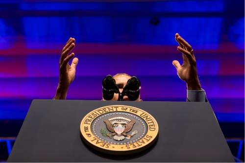 President Barack Obama gestures as he speak at the National League of Cities annual Congressional City Conference in Washington, Monday, March 9, 2015. Targeting stagnant wages in an otherwise improving economy, the president is calling on employers, educational institutions and local governments to ramp up training and hiring of high-technology in an effort to drive up higher-income employment.  (AP Photo/Jacquelyn Martin)
