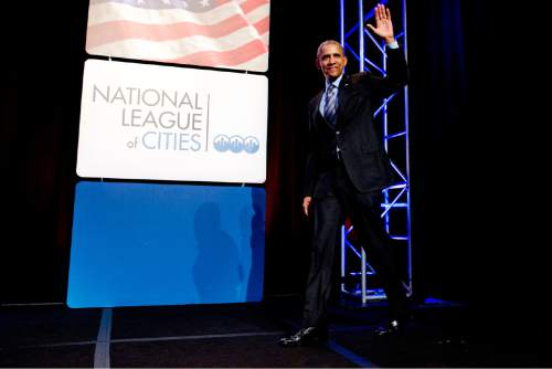 President Barack Obama arrives to speak at the National League of Cities annual Congressional City Conference in Washington, Monday, March 9, 2015. Targeting stagnant wages in an otherwise improving economy, the president is calling on employers, educational institutions and local governments to ramp up training and hiring of high-technology in an effort to drive up higher-income employment.  (AP Photo/Jacquelyn Martin)