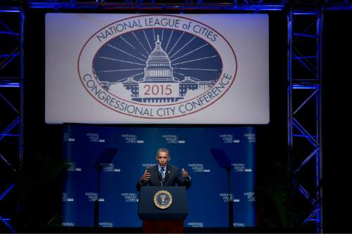 President Barack Obama speaks at the National League of Cities annual Congressional City Conference in Washington, Monday, March 9, 2015. Targeting stagnant wages in an otherwise improving economy, the president is calling on employers, educational institutions and local governments to ramp up training and hiring of high-technology in an effort to drive up higher-income employment.  (AP Photo/Manuel Balce Ceneta)