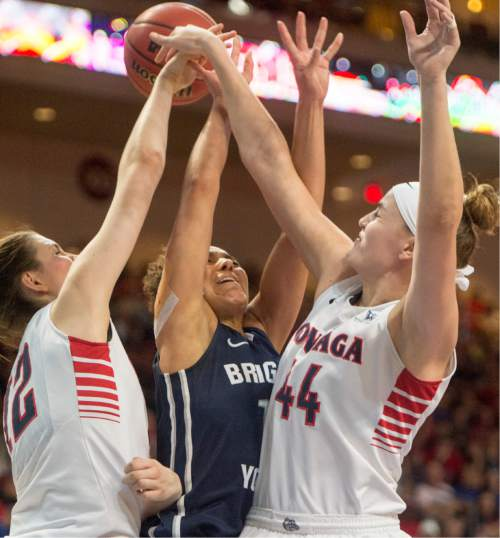 Rick Egan  |  The Salt Lake Tribune  Brigham Young Cougars guard Xojian Harry (11) has her shot blocked by Gonzaga Bulldogs center Emma Wolfram (12) and center Shelby Cheslek (44),in the West Coast Conference Basketball Championships, at the Orleans Arena, in Las Vegas,  Monday, March 9, 2015