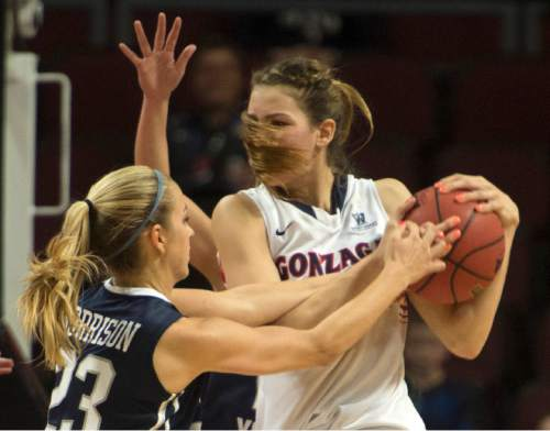 Rick Egan  |  The Salt Lake Tribune  Brigham Young Cougars guard Makenzi Morrison (23) tries to wrestle the ball from Gonzaga Bulldogs forward Sunny Greinacher (14), in the West Coast Conference Basketball Championships, at the Orleans Arena, in Las Vegas,  Monday, March 9, 2015