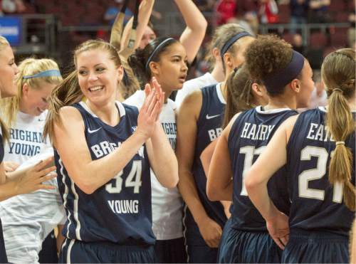Rick Egan  |  The Salt Lake Tribune  The Brigham Young Cougars celebrate after upsetting Gonzaga, in the West Coast Conference Basketball Championships, at the Orleans Arena, in Las Vegas,  Monday, March 9, 2015
