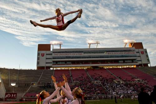Chris Detrick     The Salt Lake Tribune East High senior cheerleader Sammie Tidwell completes a toe touch basket toss during the East vs Olympus football game at Rice-Eccles Stadium Thursday November 14, 2013. East won the game 47-21.