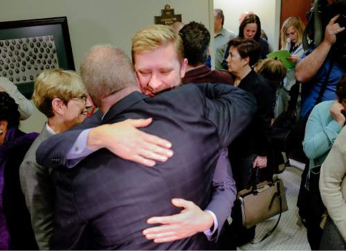 Francisco Kjolseth  |  The Salt Lake Tribune  Executive Director of Equality Utah Troy Williams, center, gives Sen. Stephen Urquhart, R-St. George, a hug after  SB296 the antidiscrimination bill,  passed the House committee with a favorable recommendation 9-2 on Tuesday, March, 10, 2015. The bill now goes to the full House for debate.