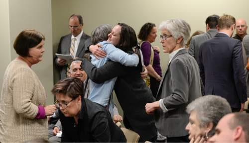Francisco Kjolseth  |  The Salt Lake Tribune  Supporters of SB296 the antidiscrimination bill, embrace after a House committee passed it with a favorable recommendation 9-2 on Tuesday, March, 10, 2015. The Senate-passed bill now goes to the full House for debate.
