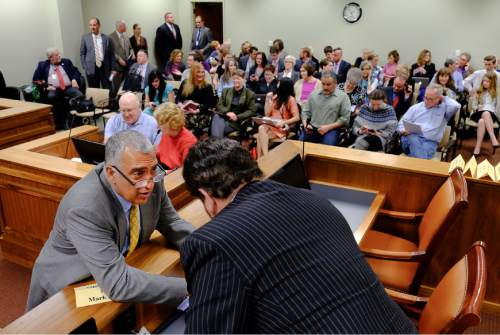 Francisco Kjolseth  |  The Salt Lake Tribune  Salt Lake County District Attorney Sim Gill speaks with with Rep. Mark Wheatley, D-Murray, before a packed House Judiciary Committee hearing for SB296 the antidiscrimination bill Tuesday, March, 10, 2015.