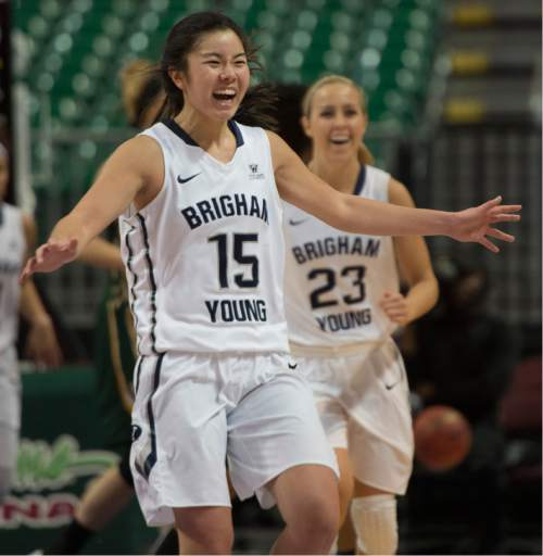Rick Egan  |  The Salt Lake Tribune  Brigham Young Cougars guard Kylie Maeda (15) and Makenzi Morrison (23)  react at the buzzer, as the Cougars defeated the San Francisco Dons 76-65, in the West Coast Conference Women's Basketball Championship game, at the Orleans Arena, in Las Vegas, Tuesday, March 10, 2015