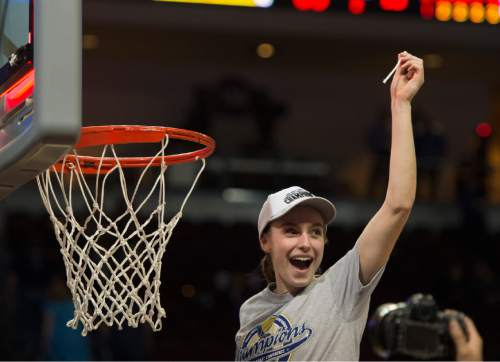 Rick Egan  |  The Salt Lake Tribune  Brigham Young Cougars guard and Tournament MVP, Lexi Eaton (21) cuts down the net, after the Cougars defeated the San Francisco Dons 76-65, in the West Coast Conference Women's Basketball Championship game, at the Orleans Arena, in Las Vegas, Tuesday, March 10, 2015