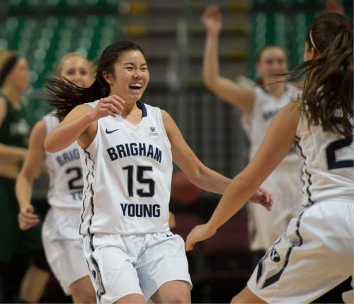 Rick Egan  |  The Salt Lake Tribune  Brigham Young Cougars guard Kylie Maeda (15) and runs to celebrate with Cassie Broadhead (20) as Makenzi Morrison (23)  runs from behind at the buzzer, as the Cougars defeated the San Francisco Dons 76-65, in the West Coast Conference Women's Basketball Championship game, at the Orleans Arena, in Las Vegas, Tuesday, March 10, 2015